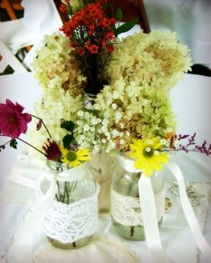 Wedding center pieces with embellished jars using Sealah No Sew Tape.  http://www.jodeesinc.com