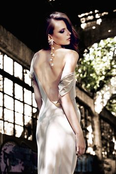 Try jewels dripping down a backless dress for an unforgettable and sultry look on your wedding day.