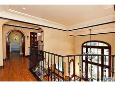 FLORAL PARK – 315 West Santa Clara Ave. Restoration won Best Historical Remodel in 2005. Foyer with spiral stairway, unique niches, living room with batchelder tile fireplace, palladium windows, archways open to dining room with french doors to sideyard, kitchen with vintage-style tile & stainless steel appliances, balcony landing with wrought iron railing, two balconies, outdoor kitchen with stainless steel BBQ. Outdoor living room with wood-burning fireplace.