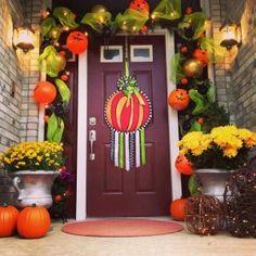 Decked the door! www.lisafroststudio.com We love Lisa Frost and her banners make great door decor!