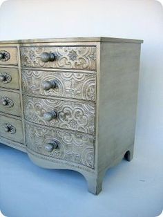 OMG -I HAVE to have one!!! The drawers are covered in paintable wallpaper and the whole thing painted with a metallic finish. #metallicpaintedfurniture