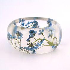 Forget Me Nots Resin Bangle Bracelet -  - Blue Real Flowers Cuff -  Pressed Flower Bracelet for the Gardener or Nature Lover. $44.00, via Etsy.