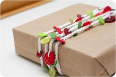 Button Garland. A cute idea to dress up plain wrapping paper and used as ribbons on presents.