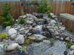 Mini waterfall with rockery