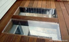 Plexiglass in the deck floor to allow light to reach the windows of the basement