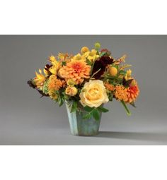 Perfect for summer or fall, this bright arrangement includes unusual garden flowers fresh from our garden.