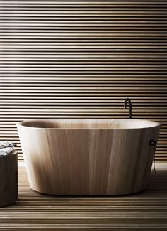 On the picture is a bathtub. It's made of wood.