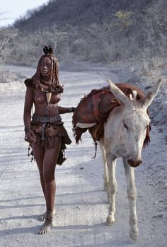 An Himba woman walking with a donkey in Namibia ~ Egy Himba nő gyalogol egy szamárral Namibiában_photo by Danita Delimont Stock Photography African Tribes, African Women, Beautiful Black Women, Beautiful People, Afrika Corps, Art Africain, Tribal Women, Tribal People, African Culture