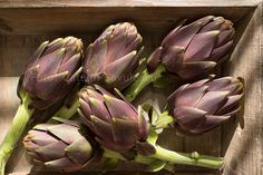 Artichokes in a wooden crate