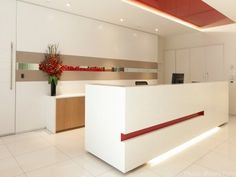 Defence Bank's reception desk combines elegance with a modern, clean slimline look. The bold splashes of red promote brand recognition. Brand Promotion, Reception Areas, Office Interiors, Desk, Concept, Elegant, Modern, Projects, Inspiration
