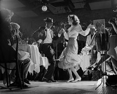 1940s New Orleans jazz night club   Like if someone were to start dancing it would be real close to the patrons, very intimate vibe