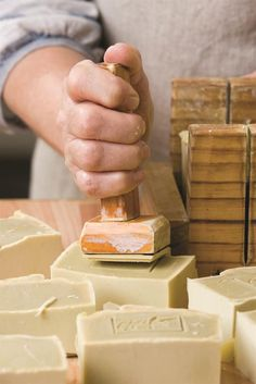 Stamping freshly cut soap. Olieve & Olie artisan soap and natural body products. Australian grown and made.