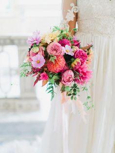 Spring Wedding Bouquet of colorful dahlias, garden roses, cosmos, zinnia, and greens