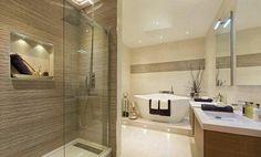 baño con tina,  en tonos beige