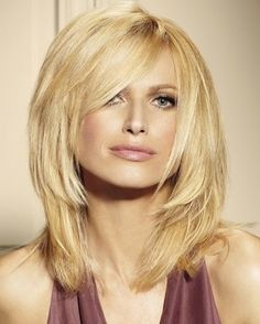 Three layers, distributed evenly through to shoulder length allows the hair to beautifully accentuate the jawline and neck. The side-swept bang is a fitting asymmetrical element to make your image even sexier.