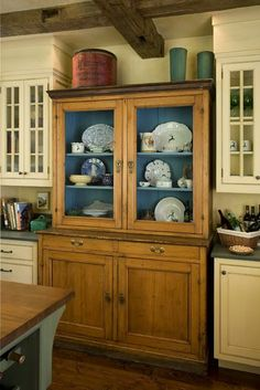 great idea...old cabinet in between your kitchen cabinets!