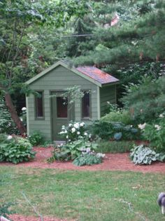 Need to paint my shed this color green, extend the flower bed on the left side so that it goes in front of the left side of shed and add a cute paver walkway. Then it will look like it belongs there instead of it looking like an ugly metal shed plopped down in the right corner of my yard.