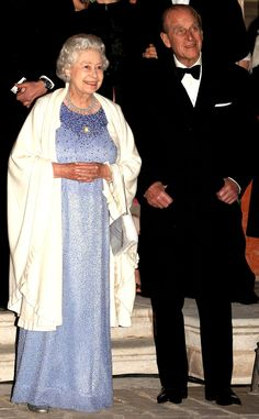 2006 from Queen Elizabeth II's Royal Style Through the Years  The Queen joined Prince Phillip in watching a firework display to honor of her birthday wearing an ombré gown, silver heels and cream shrug.