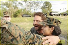 Gerard Butler Accepts Invite to Marine Corps Ball (Video): Photo #3590504. Gerard Butler puts his fists up while posing with marines at Camp Pendleton on Friday afternoon (February 26) in San Diego, Calif.    The 46-year-old actor visited…