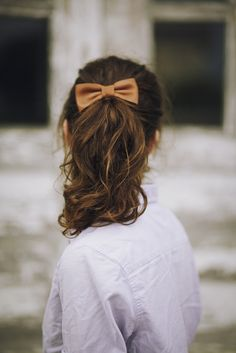 An easy ponytail with a classic Leather Bow