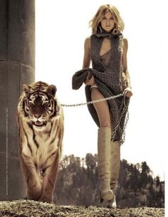 Because I want to be the goddess walking that tiger at the end of my chain... wearing those boots.