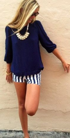 Spice up a simple outfit by layering fun necklaces and patterned shorts!
