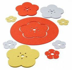 Kukka trivets, coasters and placemat wool felt). New colors for fall rosehip orange & grey-blue Verso Design Finland Orange Grey, Blue Grey, Hot Pads, Wool Felt, A Table, Tabletop, Coasters, Kids Rugs, Placemat