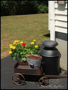 antique wagons make excellent planters..adds lots of charm to any flower