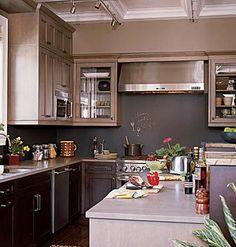 A kitchen with a chalkboard backsplash. - I love this kitchen idea!