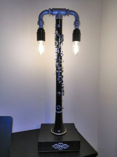 An old dysfunctional clarinet repurposed into a table lamp. A Table, Table Lamp, Clarinet, Desk Lamp, Repurposed, Lamps, Lights, Home Decor, Highlight