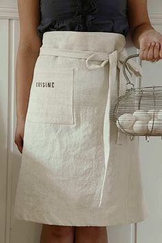 <3 absorbent white aprons