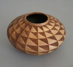 Wood Turning by Jerry Johnson  The half-triangle squares appeal to the quilter in me. =)