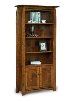 Amish Boulder Creek Bookcase with Four Shelves and Two Doors For rows of books, figurines and more, the Boulder Creek shows off solid wood beauty. From the hand sanded finish to the gorgeous inlays, this wood furniture is built with care to last. Custom made in choice of wood and stain. Built in Amish country. #bookcase #office