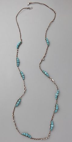 "Chan Luu Turquoise Layering Necklace This braided waxed-linen necklace features graduated, polished turquoise beads and assorted, faceted sterling silver beads. Hook-and-eye closure. * 44"" (112 cm) long."