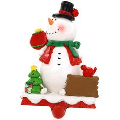 "With a cool design incorporating a snowman, a cardinal, and a Christmas tree, this charming stocking holder is ready to show off your favorite stocking this holiday season! Charmingly crafted of clay-dough in a myriad of colors, this 6½"" tall stocking holder features a weighted metal base for exceptional stability."