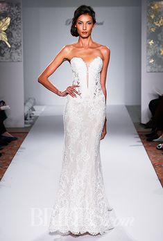 A form-fitting lace #weddingdress | Brides.com