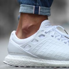 huge selection of e849f 287e0 Porsche Design collaborates with adidas to deliver a clean slick design of  the UltraBoost in pure white. Unique waffle pattern in the overlay replaces  the ...
