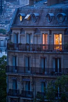 Love.this.picture.  Completely captures the most fabulous thing about visiting Paris--the amazing buildings with their amazing windows, and imagining the lives of the people in that flat with the lights on.