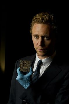 Tom Hiddleston holds the original 600-year-old Henry V seal at the Shakespeare exhibition at The British Museum - 22 Jun 2012 torrilla.tumblr