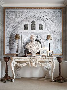 A dramatic—and decidedly classical—carved console vignette, complete with a marble bust.