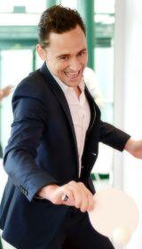 Tom playing ping pong