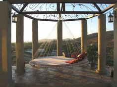 i want this hanging bed outside! (just please don't spin me around...)