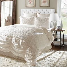 Refresh your master suite or guest room with this lovely comforter set, showcasing rosette-inspired detailing and an ivory hue.  Pro...