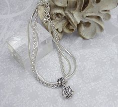 bracelet with Scales of Justice pendant, this is exactly what my mom would buy someone for a graduation present!!!!