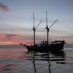 Komodo Liveaboard boat at sunset http://wickeddiving.com/komodo-liveaboard