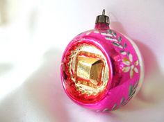 Give your tree a vintage look with this Christmas ornament. This hot pink, hand…