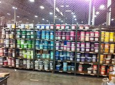 Rainbow wall of already mixed buckets of PMS colors.  We custom mix our inks per customer specs.  This is just one of many shelves full of colors.  I bet we have your color already at Visual Impressions!  www.visualimp.com
