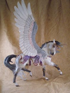 This was an older commission I started last year. A customized Breyer Esprit using Moody wings. only a few small changes *move front leg *moved head and neck *Moody wings *sculpted tack *new mane p. Pegasus, Bryer Horses, Horse Armor, Unicorn Pictures, Painted Pony, Unicorn Art, Horse Sculpture, Carousel Horses, Equine Art
