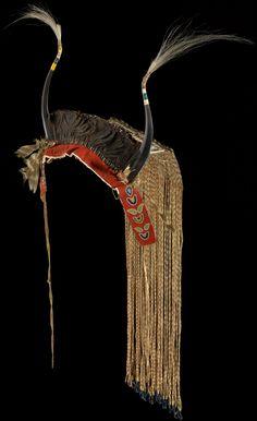 Assiniboine antelope-horn headdress ca. 1850 Saskatchewan, Canada Antelope horn, deer hide, porcupine quills, feathers, horsehair, red wool, brass bells, glass beads