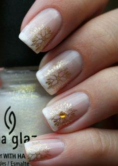 Fancy gold french - sponged tip to look more like a gradient, then stamped gold flower/snowflakes with rhinestone accents